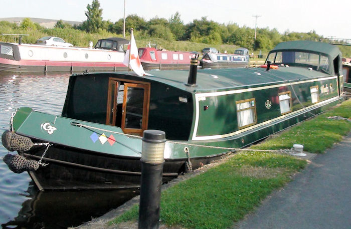 Woody the barge cruiser, rebuilt by a craftsman of the waterways